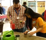 Brian Yoder helps fair goes plant seed