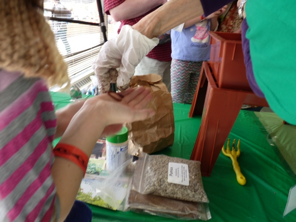 Holding worms from the Worm Composting Activity MiniMaker Faire 2015
