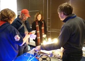 Jeff Elliott demonstrates variety of energy saving light bulbs